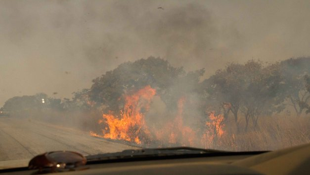 Driving throught the veld fires en-route to Antelope Park